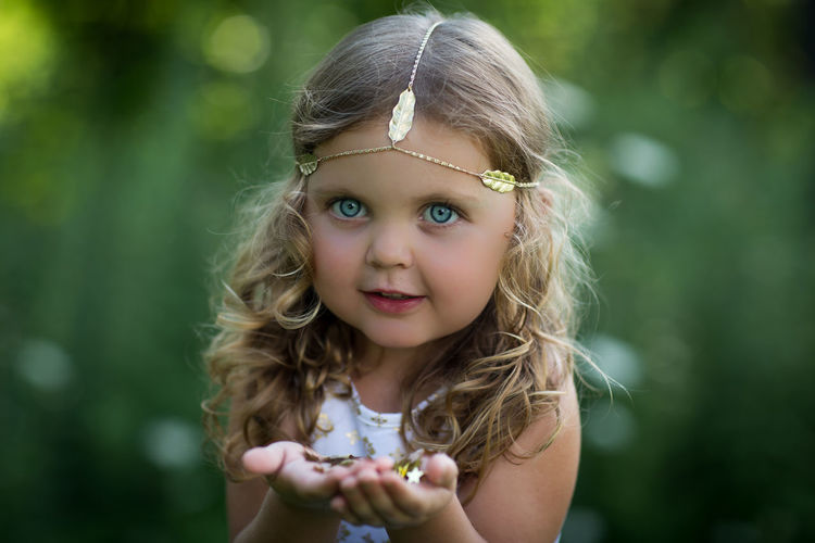 Blue Eyes Child Childhood Children Only Close-up Day Front View Girls Gold Green Color Head Jewelry Holding Nature One Girl Only Outdoors Portrait