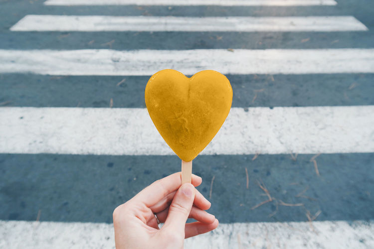 Love Paint The Town Yellow Candy Close-up Day Food Food And Drink Freshness Heart Heart Shape Holding Human Body Part Human Finger Human Hand Ice Cream Love One Person Outdoors People Real People Sweet Food Temptation Unrecognizable Person Yellow
