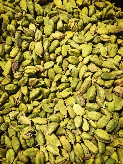 Closeup of Cardamom for sale in a grocery Plant Green Seed Cardamon Full Frame Backgrounds No People Abundance Day Nature Green Color Food And Drink Pattern Repetition Plant Growth Healthy Eating Textured