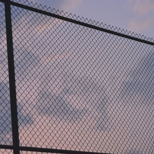 Fence Barrier Boundary Chainlink Fence Architecture Safety Security Protection Pattern Built Structure Wire Sky No People Day Metal Wire Mesh Nature Outdoors Building Barbed Wire