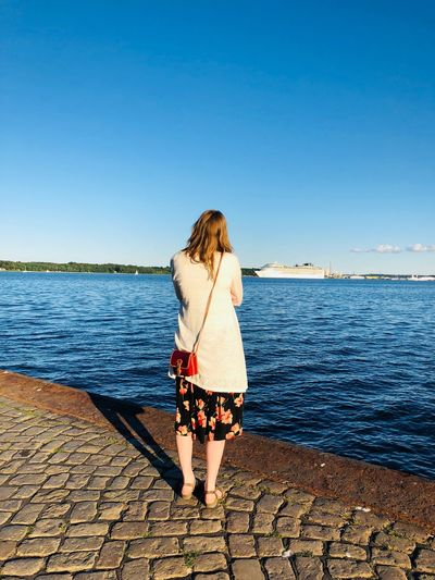 Woman at the harbour EyeEm Selects Water Sky Clear Sky Real People Full Length Sea Lifestyles One Person Beauty In Nature Leisure Activity Standing Rear View Scenics - Nature Outdoors Day Women Horizon Over Water