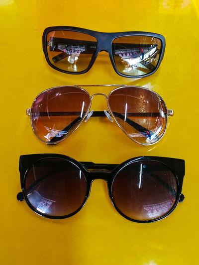 EyeEm Selects Sunglasses Eyeglasses  Eyewear Yellow Yellow Background Protection Protective Eyewear Colored Background Safety Fashion Eyesight Reflection Cool Attitude Studio Shot Summer Arts Culture And Entertainment No People Close-up Day Reading Glasses