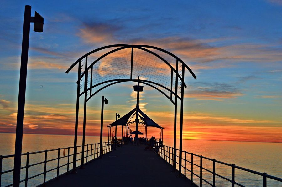 Architecture Beach Beachphotography Bridge Bridge - Man Made Structure Built Structure Connection Day Environmental Conservation Incidental People Jetty Journey Leading Outdoors Pier Railing Sunset Sunset Silhouettes Sunset_collection SUPPORT Symmetry Water Wood Wood - Material Wooden