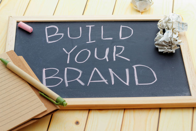 Build your brand concept Inspirations Text Branding Wooden Background Chalkboard Closeup Concept Conceptual Build Your Brand Text Words Blackboard  Text Close-up Chalk - Art Equipment Capital Letter Information