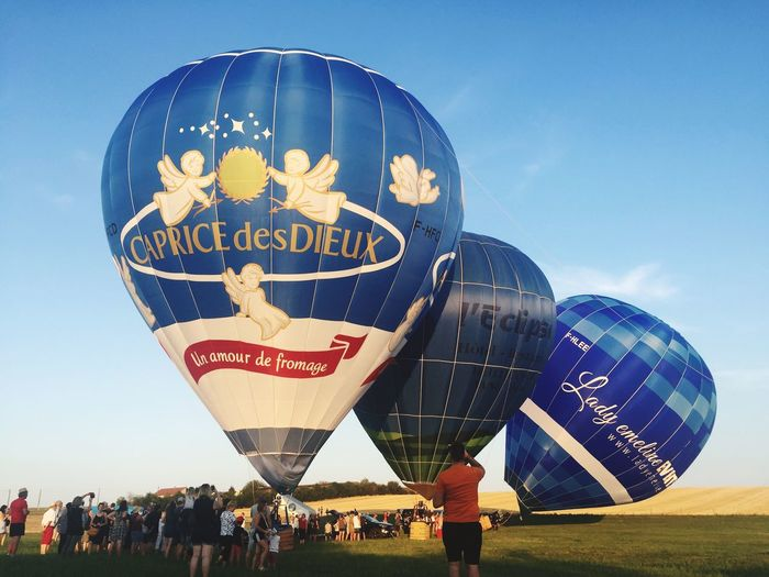 44ieme Championnat de France de Montgolfières 🤩 🇫🇷 Taking Photos Sky Nature Group Of People Day Balloon Outdoors Large Group Of People Arts Culture And Entertainment Celebration Blue Clear Sky Festival Men Hot Air Balloon Real People