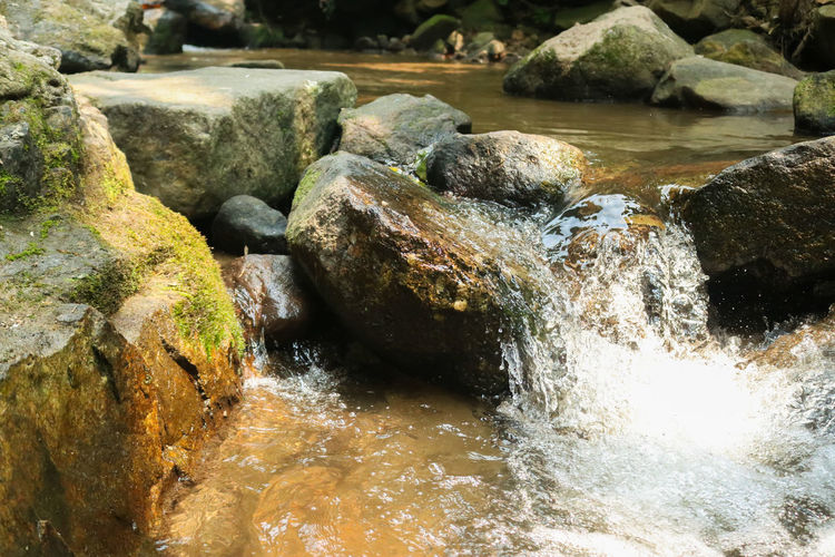 Close-up of stream flowing in rocks