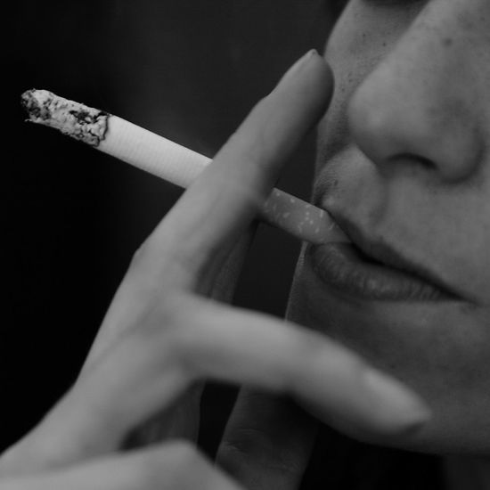 Addiction Bad Habit Burning Cigarette  Cigarette Butt Close-up Danger Hand Health Issues Holding Human Hand Indoors  One Person RISK Smoke - Physical Structure Smoking Smoking - Activity Smoking Girl Smoking Issues Social Issues Tobacco Tobacco Product Youth Youth And Cigarette Youth And Tobacco