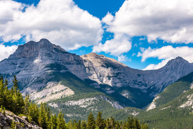 Mountain Cloud - Sky Scenics - Nature Beauty In Nature Mountain Range Sky Tranquil Scene Environment Landscape Nature Tranquility Mountain Peak Non-urban Scene No People Day Land Plant Idyllic Remote Tree Outdoors Formation Range Snowcapped Mountain Coniferous Tree