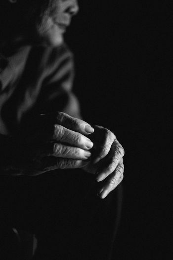 My grand-ma hands Adult Black Background Blackandwhite Bnw_captures Bnw_friday_eyeemchallenge Body Part Dark Hand Hoang Ann Human Body Part Human Hand Lifestyles Real People Week On Eyeem Inner Power