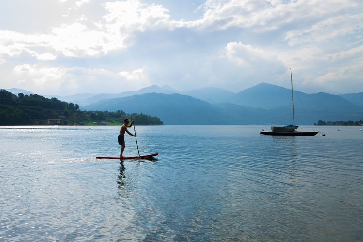 A young man standing up paddle board