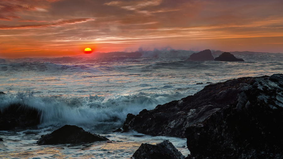 An angry sea(scape) of the Pacific Ocean. Pacific Surf Surf's Up Beauty In Nature Day Horizon Over Water Motion Nature No People Orange Color Outdoors Power In Nature Rock - Object Scenics Sea Sky Sun Sunset Tranquil Scene Water Wave Waves Waves Crashing Waves Rolling In Waves, Ocean, Nature