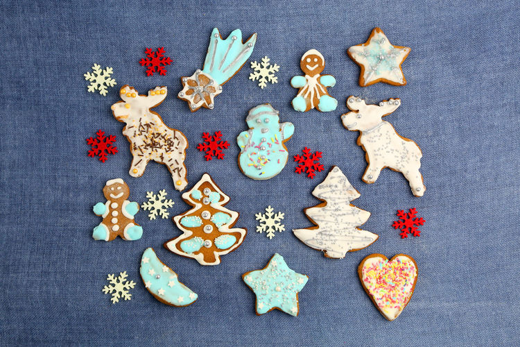 Christmas Cookies Gingerbread Homemade Food Decoration Colorful Colors Sweets Sweet Handmade Blue Background Textured  Cookie Shape Food And Drink Baked Star Shape Indoors  Celebration Directly Above High Angle View Variation Choice No People Freshness Creativity Sweet Food Representation Holiday Design Icing Tree Reindeer Stars Heart