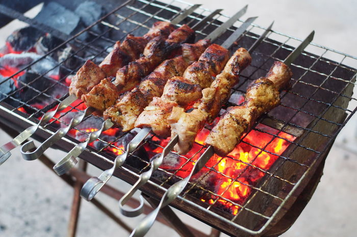 BBQ Barbecue Barbecue Grill Burning Char-grilled Dinner Fire Fire - Natural Phenomenon Flame Focus On Foreground Food Food And Drink Freshness Grilled Heat - Temperature Meat Metal Nature No People Outdoors Preparation  Preparing Food Shashlyk Skewer Snack