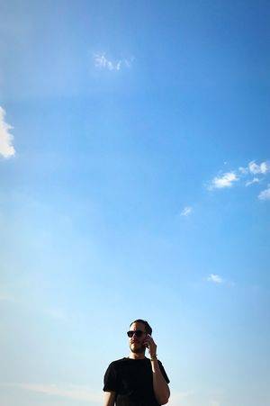 Business Man Business Men Sky Cloud - Sky One Person Nature Lifestyles Low Angle View Real People Portrait Day Sunglasses Leisure Activity Young Adult Front View Adult Blue Glasses Headshot Outdoors Warm Clothing