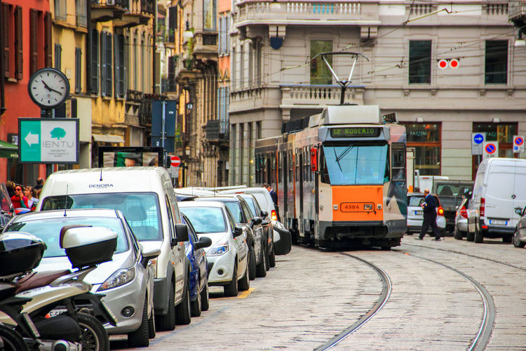 tram rides through the Cusani street in Milan, Italy Building Exterior Car City City City Life City Street Cusani Europe Italy Land Vehicle Milano Mode Of Transport Public Transportation Ride Street Tourism Town Tram Transportation Travel Urban V Vehicle