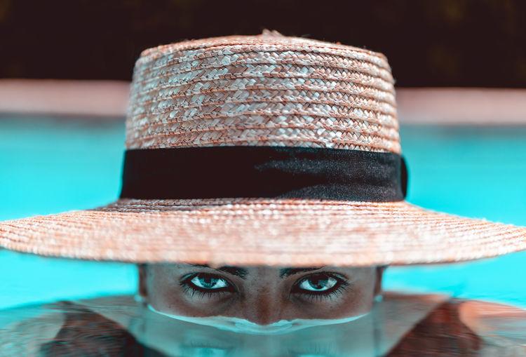 Portrait of woman wearing hat in swimming pool