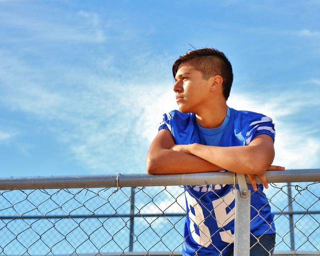 Sky Railing Outdoors Low Angle View Cloud - Sky One Person Blue Day People From My Point Of View The Week On EyeEm The Week Of Eyeem The EyeEm Facebook Cover Challenge American Football Field Team Sport American Football Player Teenager Boy Model Modeling Summer Exploratorium