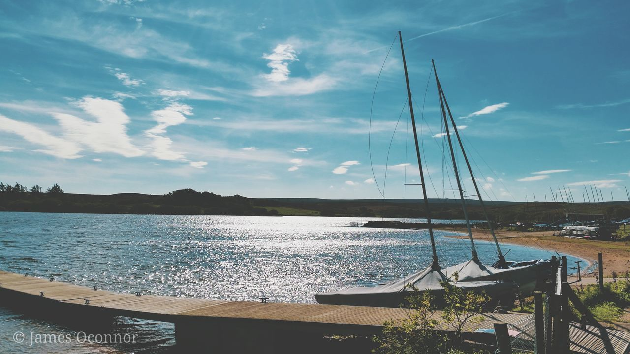 water, sky, cloud - sky, nautical vessel, scenics - nature, transportation, beauty in nature, tranquility, mode of transportation, nature, sea, tranquil scene, no people, sailboat, day, outdoors, moored, non-urban scene