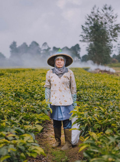 "From the series ""Mountain people of Java"" INDONESIA Local Portrait Of A Woman Portraits Travel Travel Photography Travelling Agriculture Canon Day Field Full Length Human Looking At Camera Nature One Person Outdoors Portrait Portrait Photography Portraiture Real People Rural Scene Standing Tea Plantation  Travel Destinations Fresh On Market 2017 Inner Power Visual Creativity The Portraitist - 2018 EyeEm Awards"