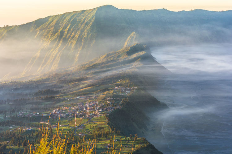 Magnificent sunrise at Bromo Tengger Semeru National Park ASIA INDONESIA Light Misty Morning National Park Nature Bromo Destination Hill Landscape Mountain Popular Sky Summer Sunrise Tourism Travel Destinations Volcanic Crater Volcano