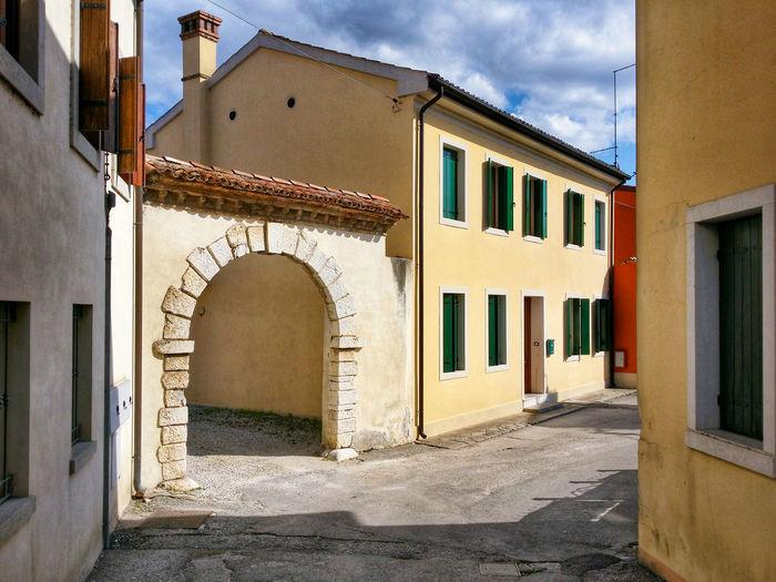 Footpath amidst houses at cordignano
