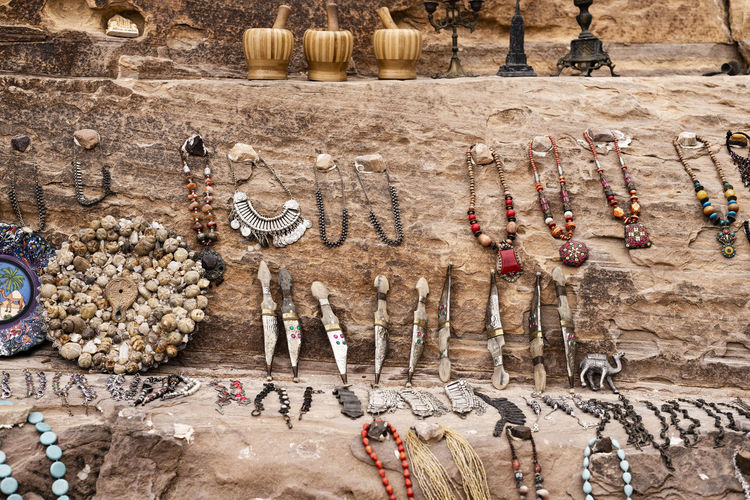 High angle view of antiques for sale on rock formation