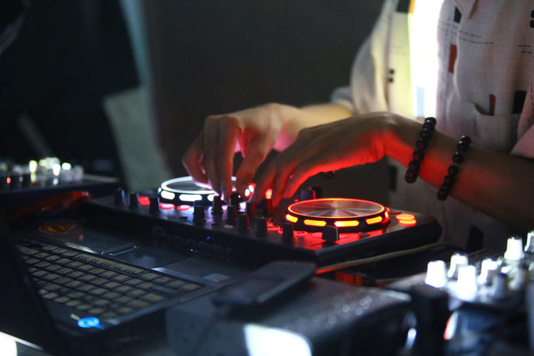 Midsection of dj at event