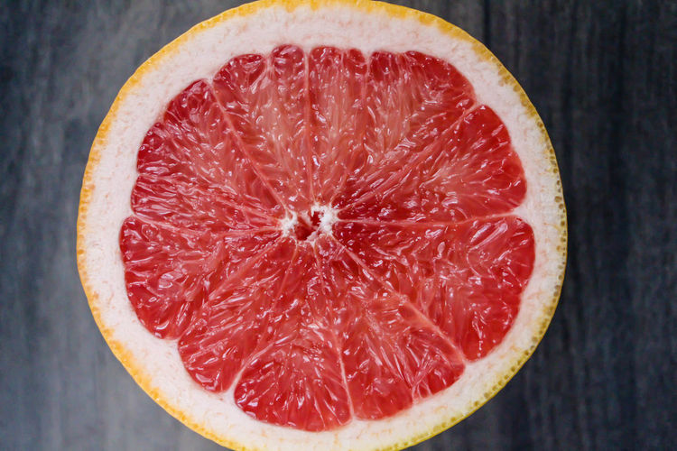 grapefruit on the wooden background Food Healthy Eating Fruit Wellbeing Freshness SLICE Close-up Citrus Fruit Grapefruit No People Still Life Halved Juicy Directly Above Red Blood Orange High Angle View Orange Half Natural Sliced Sweet Vitamin Wooden Wood View Vibrant Tropical Raw SLICE Pink Healthy Organic Fresh Exotic Diet Dark Bright Health Cut Closeup Close Background Citrus  Dieting Red Yellow Object Freshness Colorful