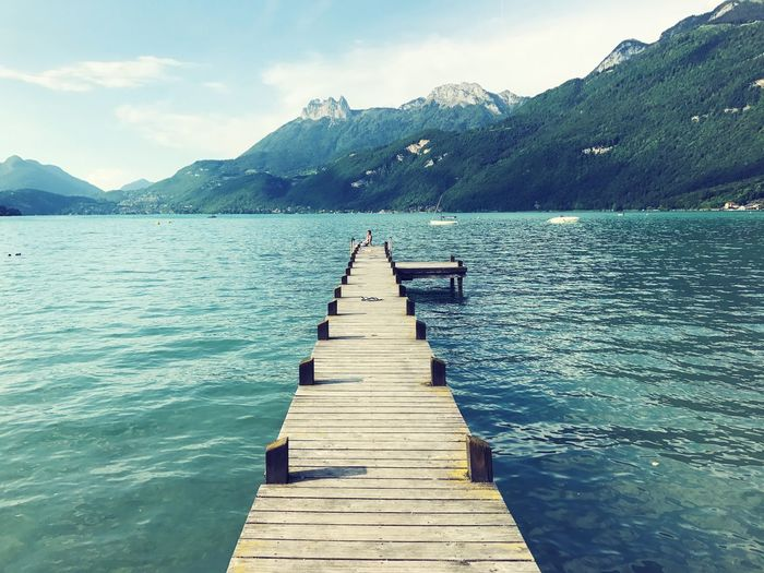 Jetty Mountain Pier Beauty In Nature Nature Scenics Water Tranquility Lake Tranquil Scene Jetty Day Outdoors The Way Forward Mountain Range Wood Paneling Sky EyeEmNewHere