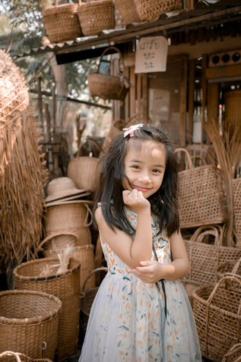 Portrait of a smiling girl in basket