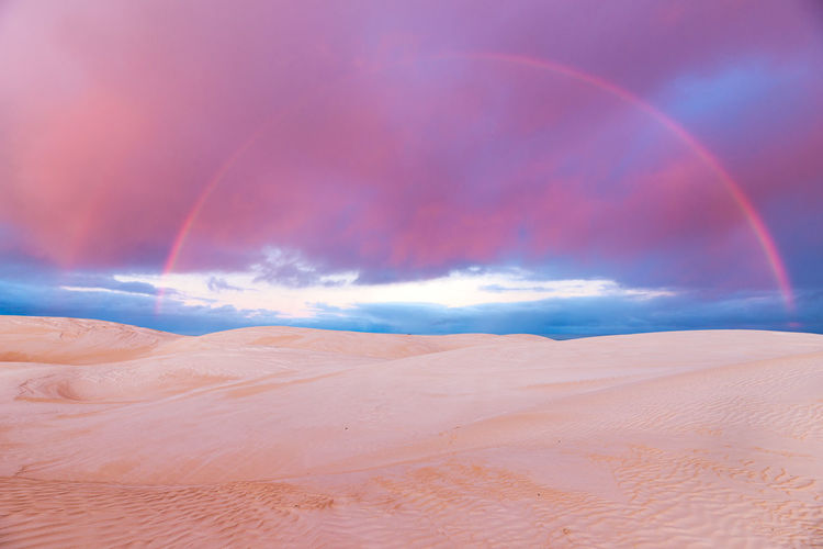 Sky Scenics - Nature Beauty In Nature Cloud - Sky Tranquil Scene Tranquility Landscape Non-urban Scene Rainbow Land Idyllic Environment Nature No People Sand Climate Remote Desert Sand Dune Arid Climate Sunrise Dawn Morning Colorful Australia Travel Destinations Travel