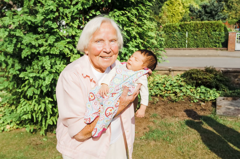 Portrait of senior woman with baby