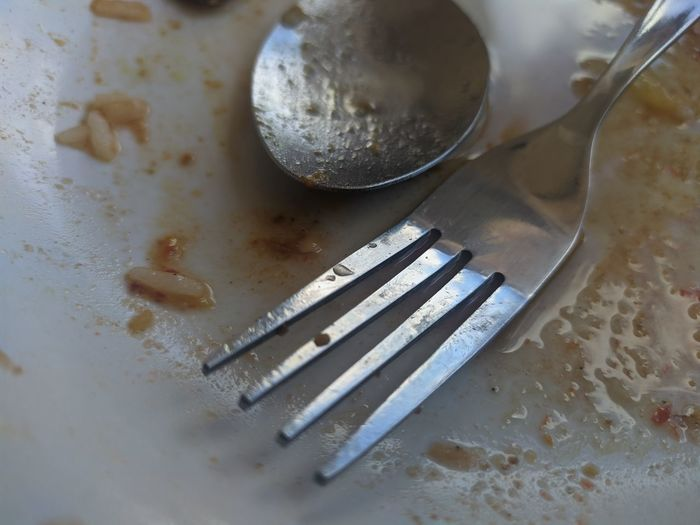 High angle view of fork on table