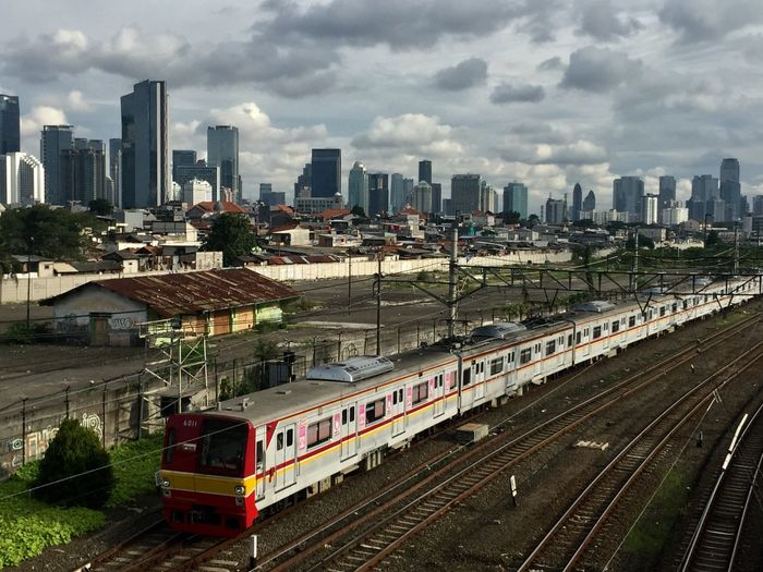 Commuterline at Jakarta City Rail Transportation Transportation Track Architecture Building Exterior Mode Of Transportation Railroad Track Public Transportation Train - Vehicle Built Structure Sky Cloud - Sky City High Angle View No People Nature Building Day Travel