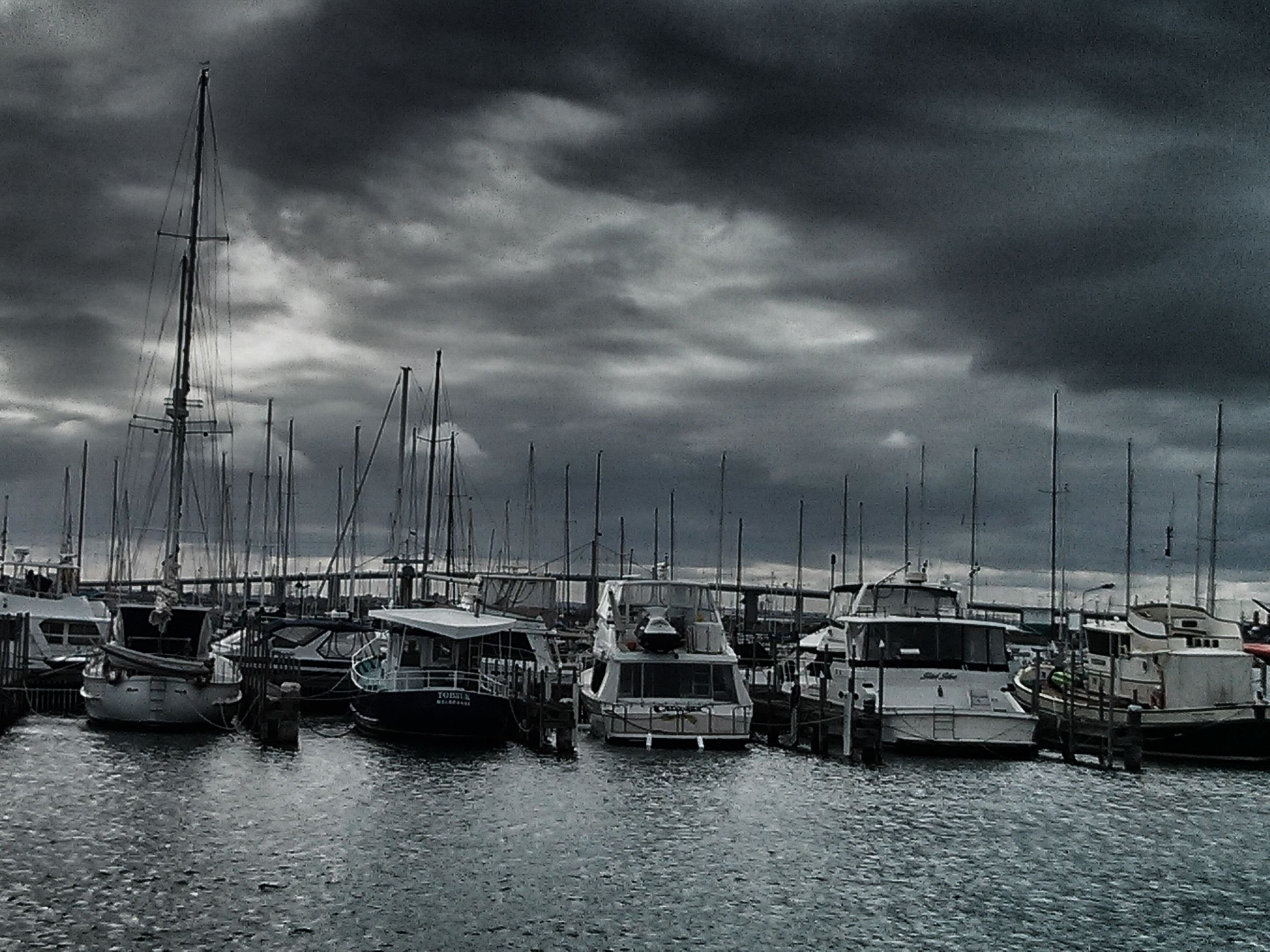 nautical vessel, transportation, moored, boat, mode of transport, water, sky, sea, cloud - sky, cloudy, mast, harbor, sailboat, cloud, waterfront, nature, in a row, tranquility, travel, marina