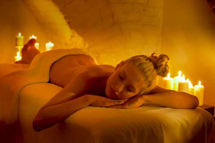 Young woman resting in illuminated spa