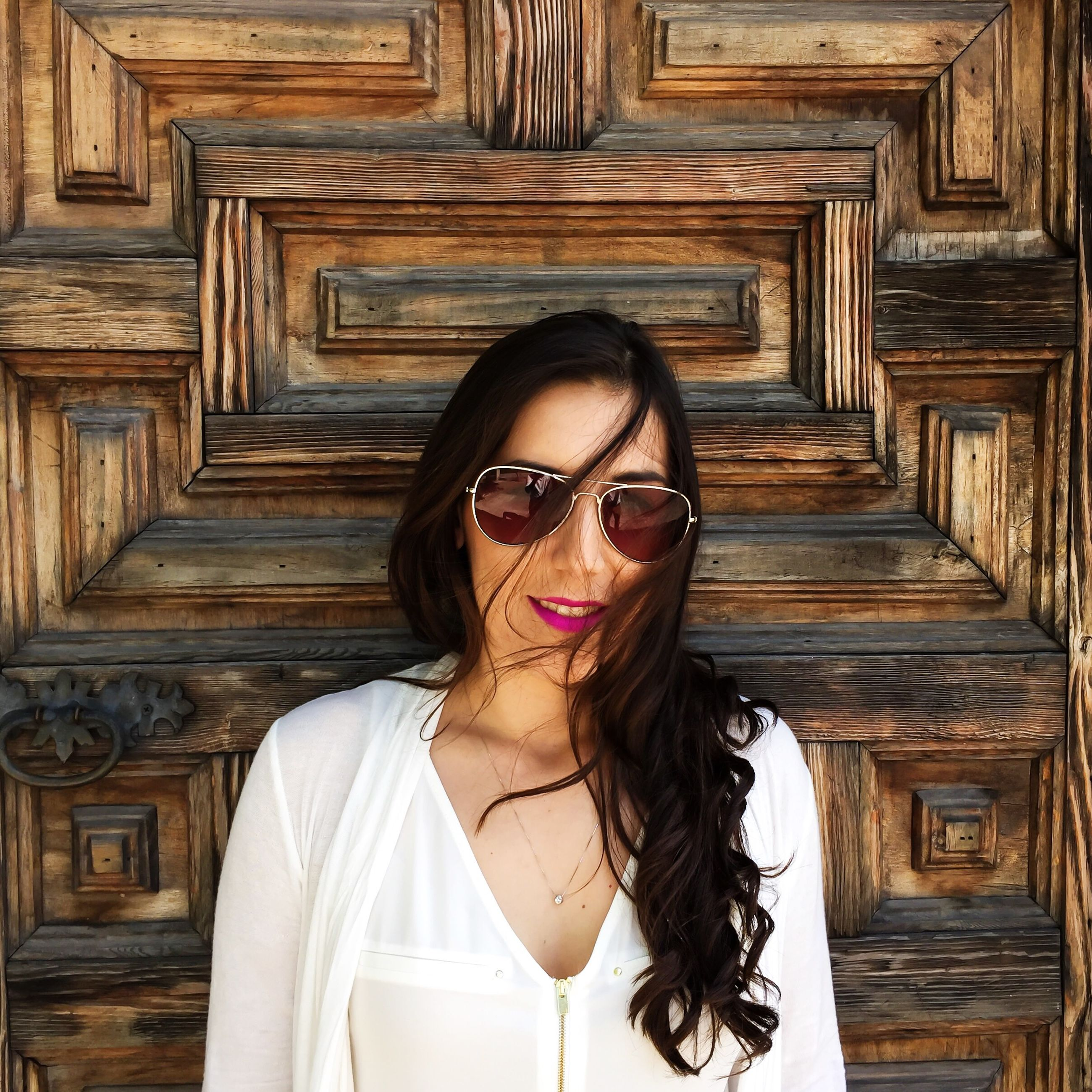 young adult, looking at camera, portrait, young women, front view, person, lifestyles, sunglasses, smiling, casual clothing, indoors, leisure activity, long hair, wood - material, standing, beauty, headshot