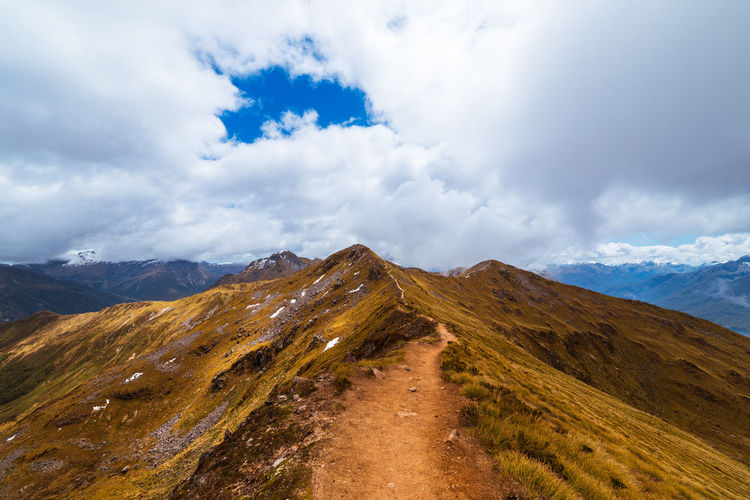 Pathway along the ridge on the Kepler track Cloudy Nature Path Tranquility Travel Beauty In Nature Colorful Day Landscape Mountain Mountain Range Nature New Zealand No People Outdoors Pathway Ridge Scenics Sky Track Tranquil Scene Tranquility Travel Destinations
