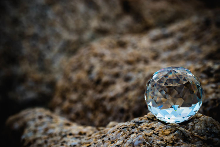 Close-up of crystal ball on rock