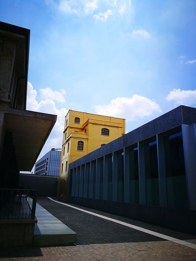 The gold tower is gaudy but perfect among the three new buildings and the rest of the refurbished 19,000 square meters of the old distillery dating back to 1910. The Week on EyeEm The Architect - 2018 EyeEm Awards Arts Culture And Entertainment Italy Prada Foundation FondazionePrada Fondazione Prada Best EyeEm Shot Milan Chic Milan Milano Milan,Italy Milanocity Milano Italy Milan Italy Chic Golden Building Golden Buildings Fashion Hot Spot Arts Culture And Entertainment Art Museum Architecture_collection Architecturelovers Architecture Cloud - Sky Building Building Exterior Palace