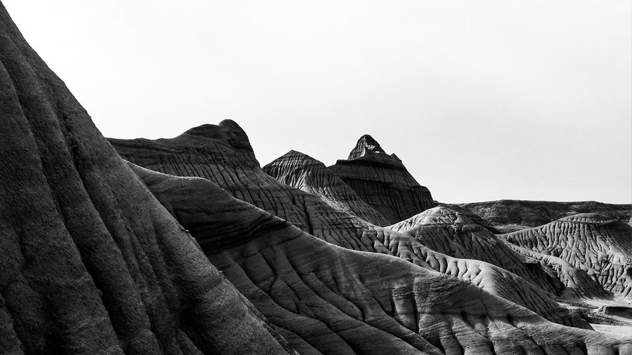 Low angle view of rock formations in desert against clear sky