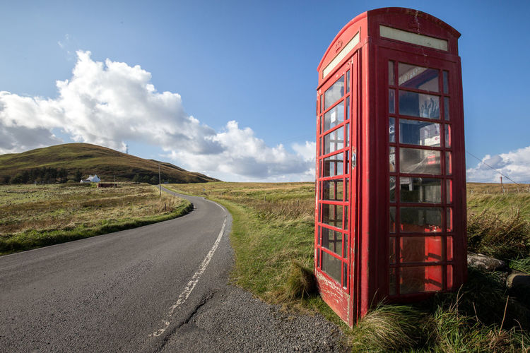Cloud - Sky Communication Connection Day Grass Landscape Nature No People Outdoors Pay Phone Red Road Scenics Scotland Sky Skye Telephone Telephone Booth