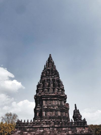 Low angle view of old temple against sky