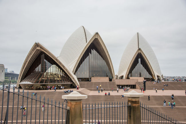Sydney,NSW,Australia-November 19,2016: Sydney Opera House landmark architecture with tourists on overcast day in Sydney, Australia. 20th Century Architecture Exploring Façade New South Wales  Roof Rooftop Steps Sydney Opera House Touring Tourist Venus Arts Culture And Entertainment Building Exterior Crowd Expressionist Famous Place Group Of People Landmark Opera House Real People Sydney Tourism Travel Destinations Windows