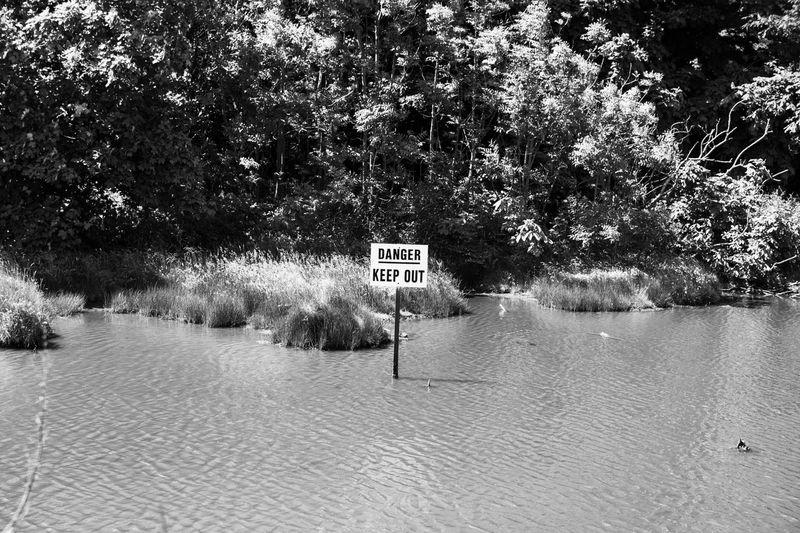 Danger, Danger!! EyeEm Nature Lover Pond Nature Danger Black And White Water EyeEm Gallery EyeEm Best Shots Sign monochrome photography Monochrome