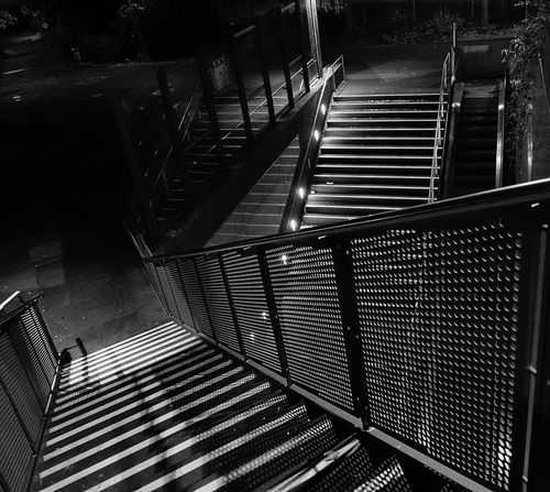 Black & White Night Photography Urban Geometry Absence Architecture Available Light Photography Built Structure darkness and light Direction Empty High Angle View Metal No People Outdoor Photography Pattern Railing Shadow Staircase Steps And Staircases Struckture HUAWEI Photo Award: After Dark
