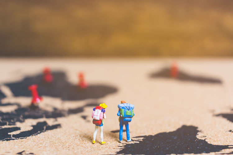 Adventure Background Backpack Backpacker Closeup Compass Concept Country Destination Figure Figurine  Group Holiday Lifestyle Little Looking Macro Male Man Map Mini Miniature Outdoor People person Searching Small Standing Summer Team Tiny Tour Tourism Tourist Toy Travel Traveler Trip Vacation Walking Women World Young