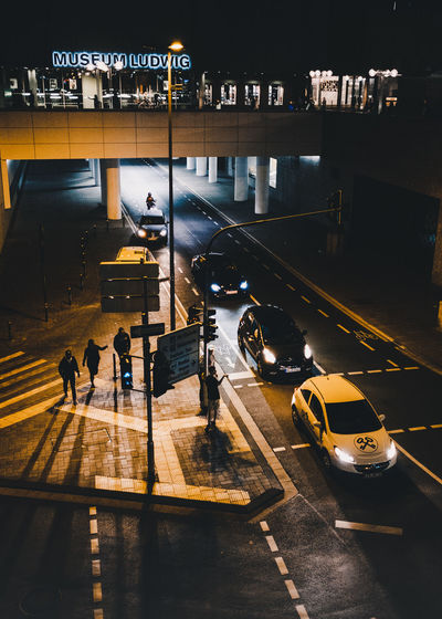 People walking on road in city at night