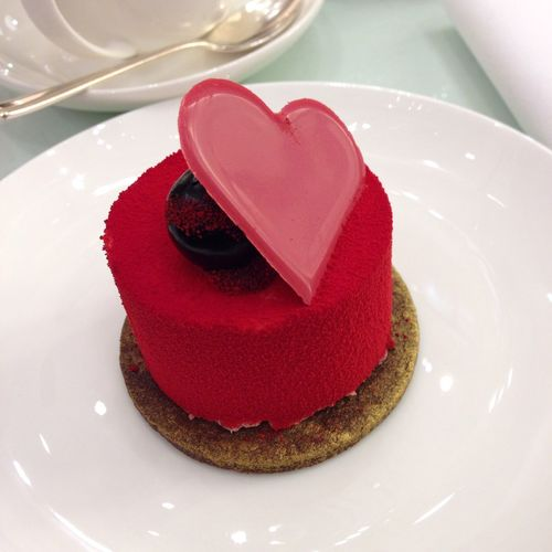 Close-up of dessert with heart shape served in plate
