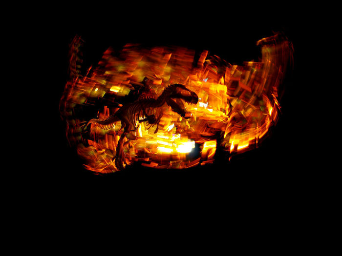 Close-up of illuminated fire against black background